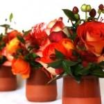Leucospermum, orange roses and berry arrangmnet