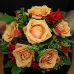 Orang roses, Alchemilla and Nareen weddinf bouquet