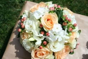 Peach rose, white phlox and Honey Hypericum bouquet