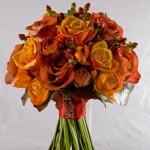 Teracotta rose, ranunculus and Hypericum bouquet