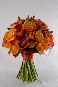 Teracotta rose, ranunculus and Hypericum bouquet